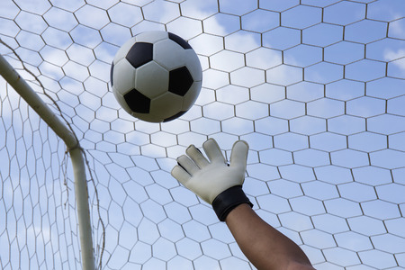 hands reaching: goalkeepers hands reaching for the foot ball