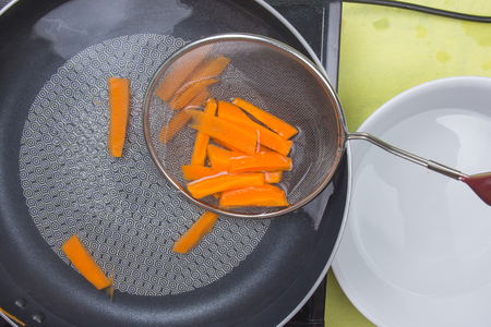 scald: Chef scald carrot with hot water  cooking steak concept
