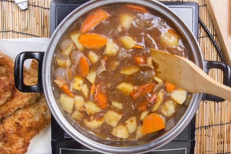 vegetable cook: Japanese pork curry in the pot  cooking Japanese pork curry paste concept