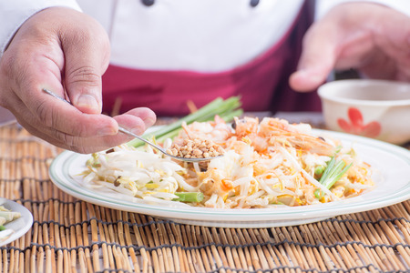 Chef decorated Pad Thai Menu with  minced Peanut bean  cooking Pad Thai concept