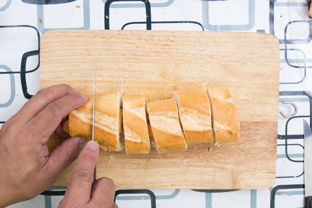 penetrate: Chef slicing bread  cooking sausage bread concept