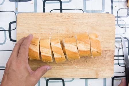 rive: Chef slicing bread  cooking sausage bread concept