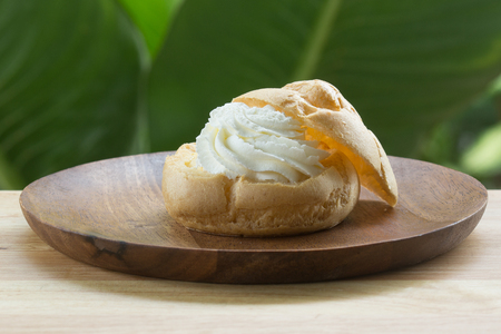 puffs: Choux Cream on plate  Cream puffs filled vanilla custard Stock Photo