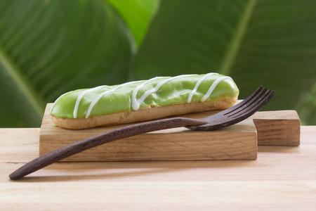 choux bun: Melon dessert eclair on the wooden plate