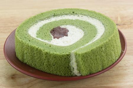 swiss roll: Green Tea Swiss Roll Cake on the plate