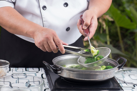 scald: Chef scald broccoli with hot water  Stir fry Broccoli concept Stock Photo
