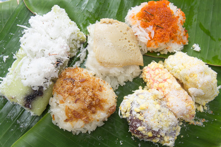 Thai dessert  Sticky rice topping with egg custard , Shrimp and sugar dry fish on banana leaf