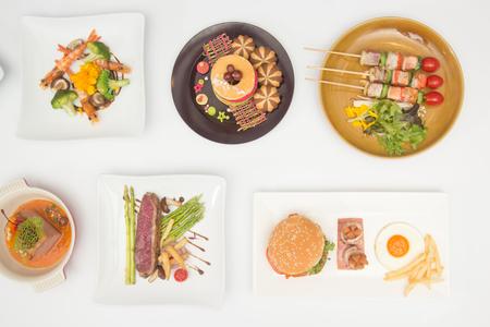 International food for dinner on white table Stock Photo