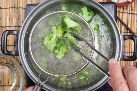 Chef boiling Broccoli in pan   cooking spicy spaghetti concept