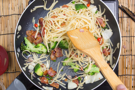 ladles: Chef stir fried Spaghetti with ladles  cooking spicy spaghetti concept