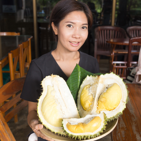 Asian Nice Woman holding Durian Tray