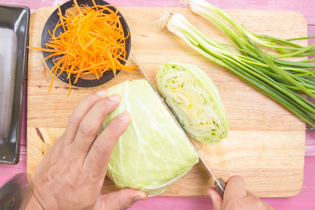 savoy cabbage: Chef cutting cabbage on wooden broad  Cooking Yakisoba concept