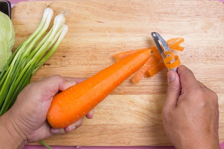 Chef peel the carrot of skin  Cooking Yakisoba concept