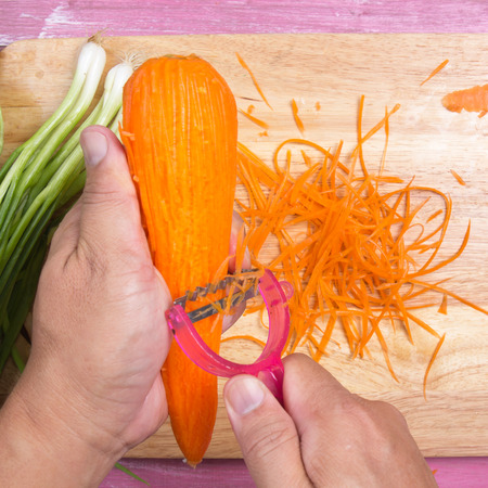Chef peel and chop carrot  Cooking Yakisoba concept Stock Photo