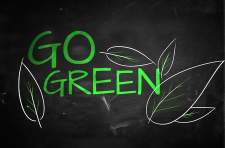 Go Green Text on blackboard photo