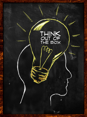 Think out of the box sketch on blackboard photo