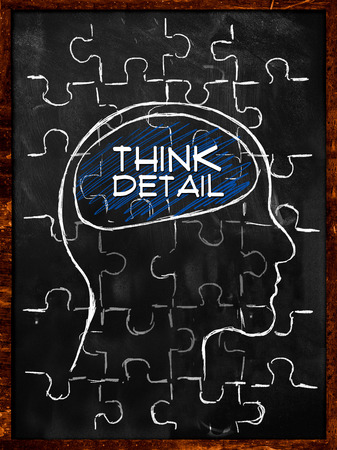 Think Detail Puzzle - On blackboard photo