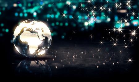 グローブ ガラス クリスタル シルバー シティの光輝く 3 D 背景のボケ味