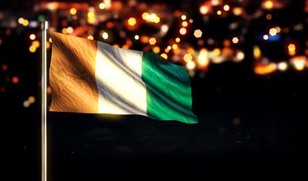 Cote D Ivoire National Flag City Light Night Bokeh Background 3D photo