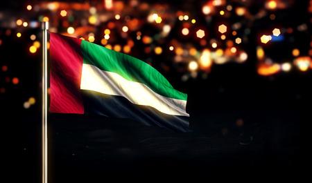 arab flags: United Arab Emirates National Flag City Light Night Bokeh Background 3D