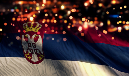 Serbia National Flag Light Night Bokeh Abstract Background photo