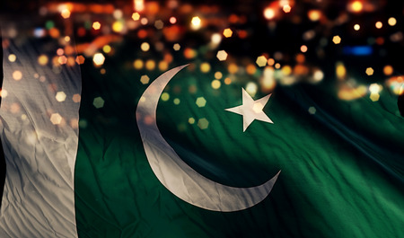 Pakistan National Flag Light Night Bokeh Abstract Background Stock Photo