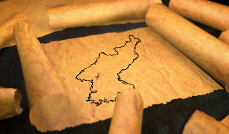 unfolding: North Korea Map Drawing Unfolding Old Paper Scroll 3D Stock Photo