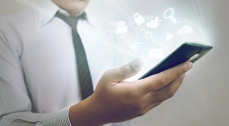 high tech: Concept of Smartphone - Asian Businessman Using High Tech Smartphone Stock Photo