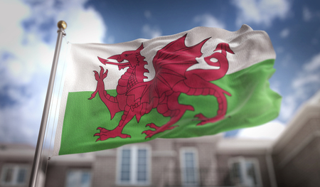 Wales Flag 3D Rendering on Blue Sky Building Background Stock Photo