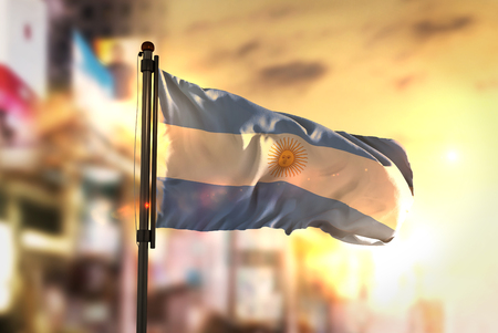 Argentina Flag Against City Blurred Background At Sunrise Backlight 版權商用圖片