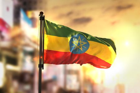 Ethiopia Flag Against City Blurred Background At Sunrise Backlight