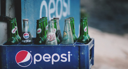 expired: Old Dusty Pepsi Bottles on Plastic Crate Sold At Thamel Street