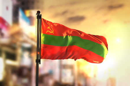 Transnistria Flag Against City Blurred Background At Sunrise Backlight