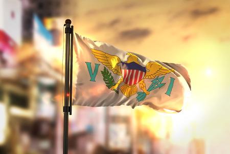 United States Virgin Islands Flag Against City Blurred Background At Sunrise Backlight