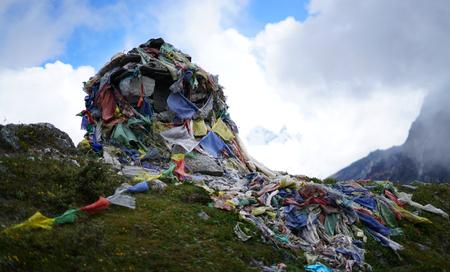 Memorial Stone, Himalayan Graveyard Covered by Prayer Flags, Everest Base Camp Trek Lobuche to Gorak Shep, Nepal Stock Photo