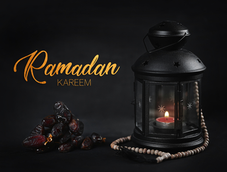 Ramadan Kareem Greeting Gold Typography. Ramadan Candle Lantern with Wooden Prayer Beads and Dates Stock Photo