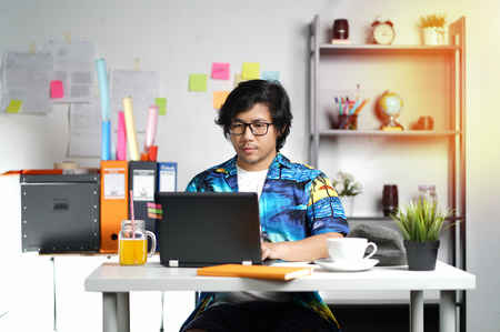 Young Man Working With Laptop on Summer Vacation Season at Office
