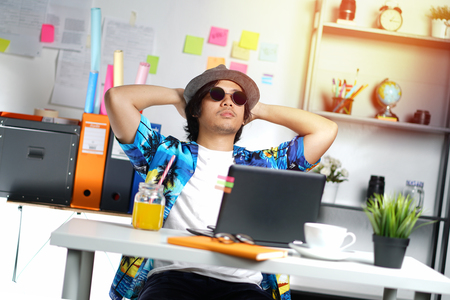 Stylish Young Professional Enjoying His Holiday While Working on Summer Vacation at Office