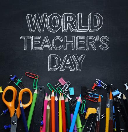 World Teacher's Day Text. School Stationary on Blackboard Top View