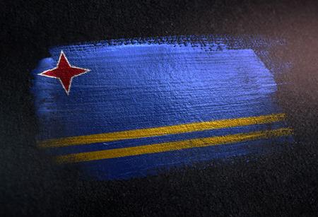 Aruba Flag Made of Metallic Brush Paint on Grunge Dark Wall Foto de archivo