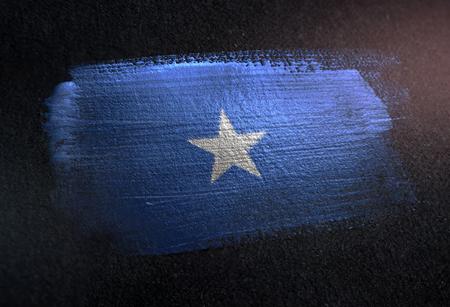 Somalia Flag Made of Metallic Brush Paint on Grunge Dark Wall