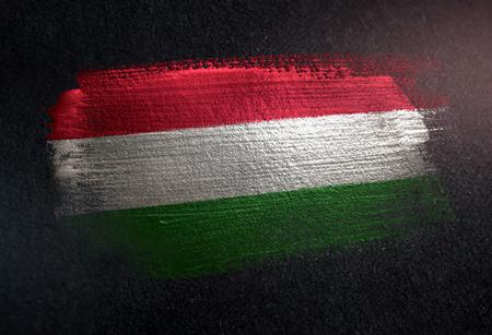 Hungary Flag Made of Metallic Brush Paint on Grunge Dark Wall