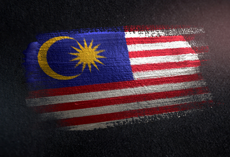 Malaysia Flag Made of Metallic Brush Paint on Grunge Dark Wall