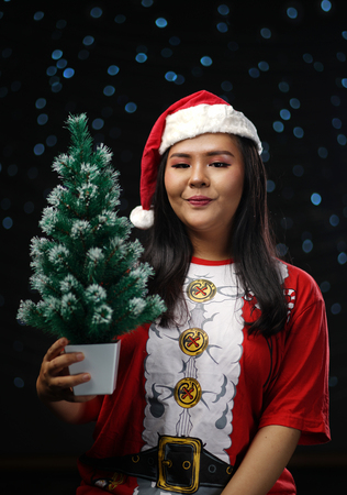 Happy Asian Girl Wearing Santa Costume Holding Small Christmas Tree