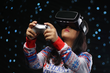 Asian Girl Playing Video Games With Virtual Reality Dark Glow Snow Background