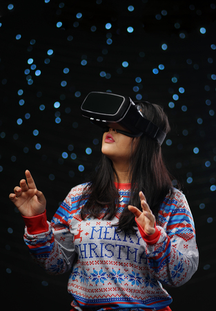 Asian Girl Wearing Virtual Reality Dark Glow Snow Background