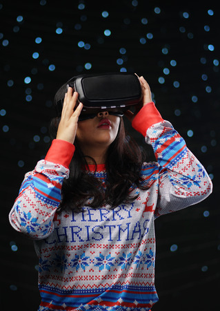 Asian Girl Playing Virtual Reality Dark Glow Snow Background