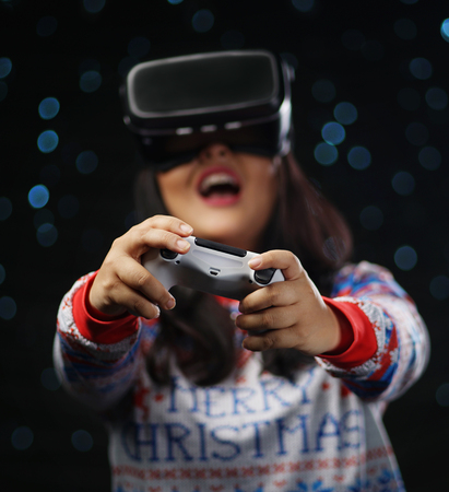 Excited Asian Girl Playing Video Games With Virtual Reality Dark Glow Snow Background