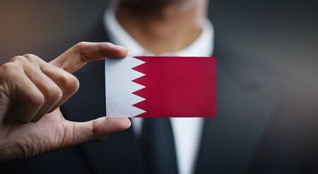 Businessman Holding Card of Bahrain Flag