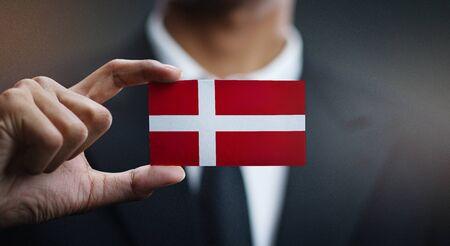 Businessman Holding Card of Denmark Flag